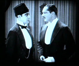Arthur Edmund Carewe as Ledoux & Norman Kerry as Raoul